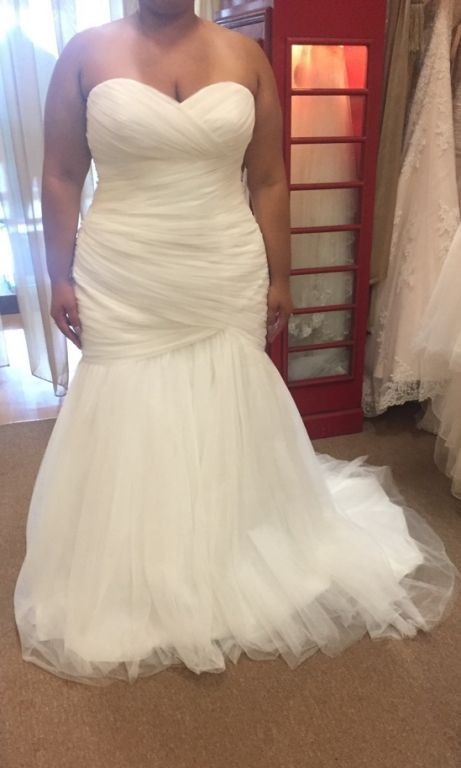 This plus size wedding gown has a ruched bodice.  This helps with a shapely fit.  Brides needing custom #plussizeweddingdresses can find many options available with our firm. You can request us to make a #replicaweddingdress that is less expensive than the original.  Or we can customize any one of our designs shown on our website.  Contact us for pricing and to see how we work with long distance brides at www.dariuscordell.com/