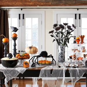 Delish's Halloween table - wrapping paper lined vase and spray painted spider mums.  very clever!