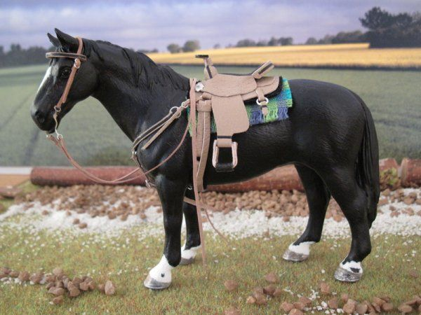 Western saddle on a custom Schleich horse