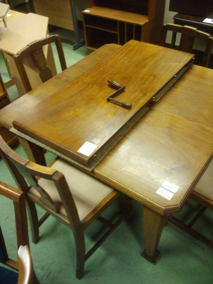 Not a wind-up! We just picked up an beautiful extending dining table with a handle ...