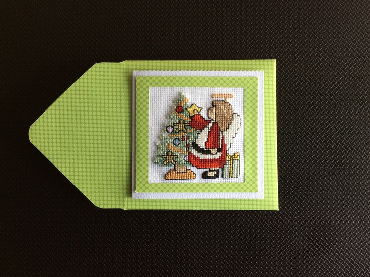 Cross Stitch Christmas Card made by Karen Miniaci. Christmas tree being decorated by Angel.