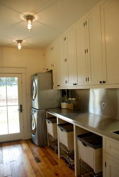 laundry room, get rolling carts instead of sliding shelves for baskets under counter.  from RH