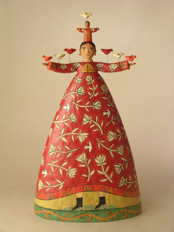 Ceramic sculpture by Lisa Smith of Santa Fe. Red Flower Woman