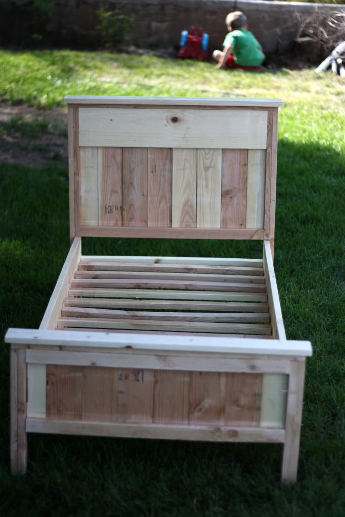 DIY Toddler Bed. Alright- a little taller using the baseboard height on each end, cute daybed! Most likely much cheaper than buying a daybed.
