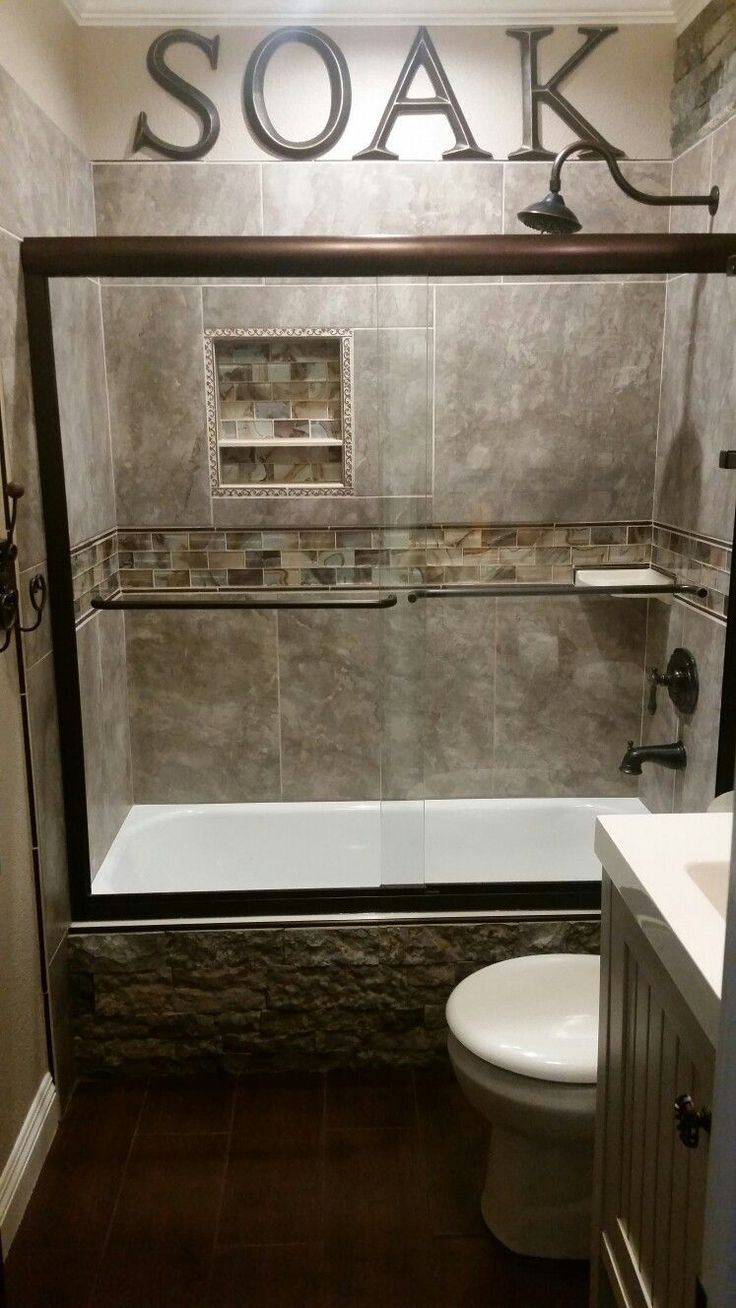 "DIY Rustic Small Guest Bathroom...accented with Airstone Faux Stone on the side of the tub, 20""x20"" tile, glass tile for accent and Kohler shower doors. Letters from Hobby Lobby!!"