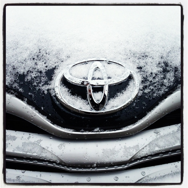 Toyota emblem with frost, snow, ice.