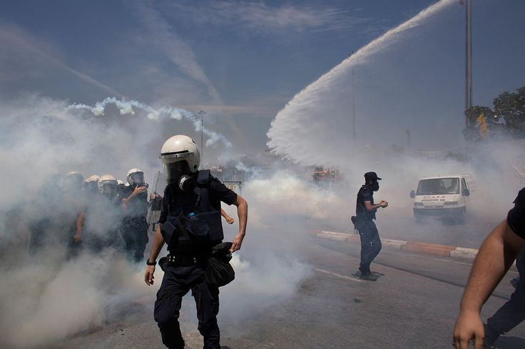 Riot police use water cannons and tear gas to disperse the crowd during a demonstration near Taksim Square, on June 11, 2013