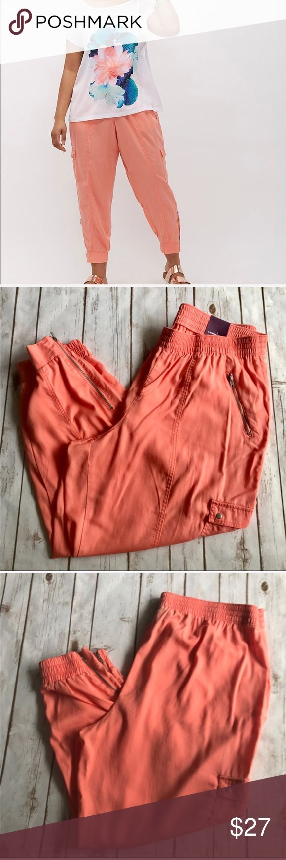 Lane Bryant Flight Pants Soft Coral Capris Lane Bryant Flight Pants Soft Coral Capris. The Flight Pant everything you love about a cargo in a relaxed jogger shape. .   • 100% lyocell. • Elastic waist.  • Elastic cuffs with zipper detail.  • Zip pocket at hip.  • Button cargo pocket • Machine wash cold.  • Approx. measure: inseam 28in, outseam 36in, cuff 6in.  • Size 18/20  💕Offers welcome on single items and on bundles💕 🛍 15% off bundles of 2+ Lane Bryant Pants