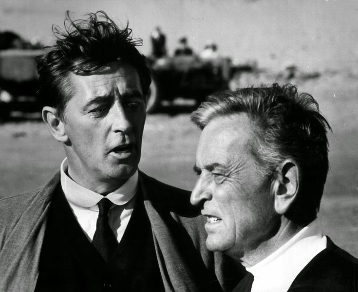 "Robert Mitchum and David Lean on the set of ""Ryan's Daughter."""