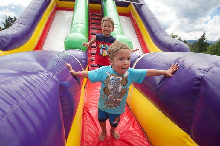 Bouncy castles at Base Camp #FairmontHotSpringsResort #BCRockiesAdventures #inflatables #bouncycastle #kids #playing #fun #activities