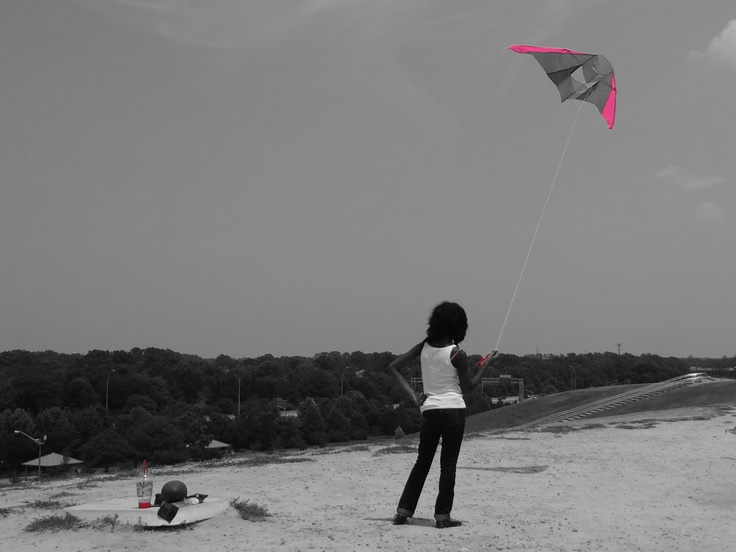 My daughter on Mt.Trashmore flying her kite in Virginia Beach.