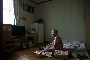 South Korean Gil Won-ok sits in her room at the NGO run 'Our Home' shelter for former 'comfort women' in Seoul, South Korea