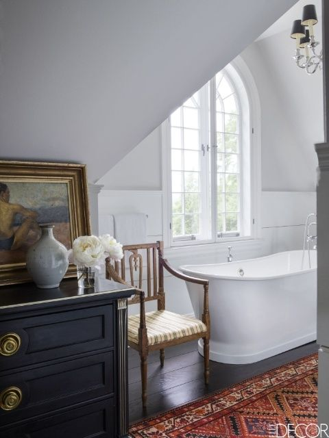 A white Sunrise Specialty bathtub sits in this small bathroom next to an antique armchair in. 1000  ideas about Small Bathroom Bathtub on Pinterest   Small tub