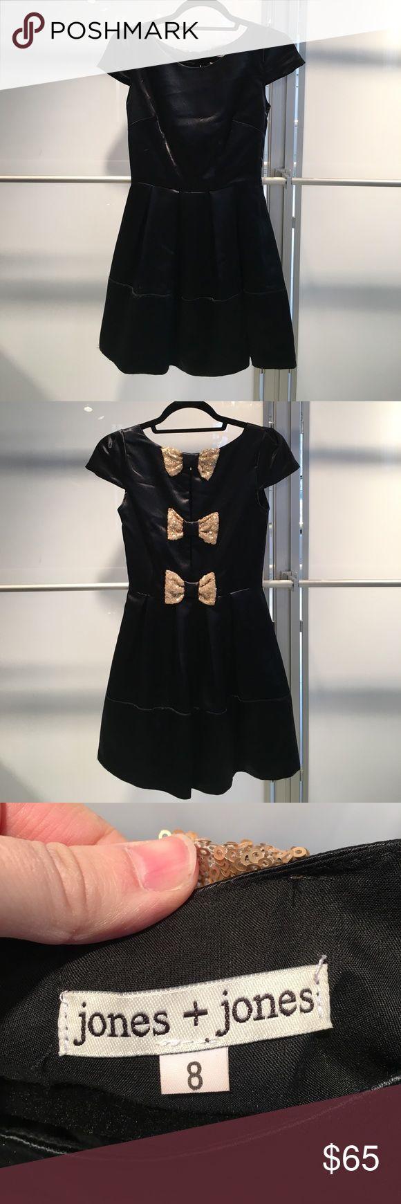 Jones and Jones black dress w/ gold bows down back Jones and Jones black dress w/ gold bows. U.K. Size 8. Fits like US size 2 Jones + Jones Dresses Mini