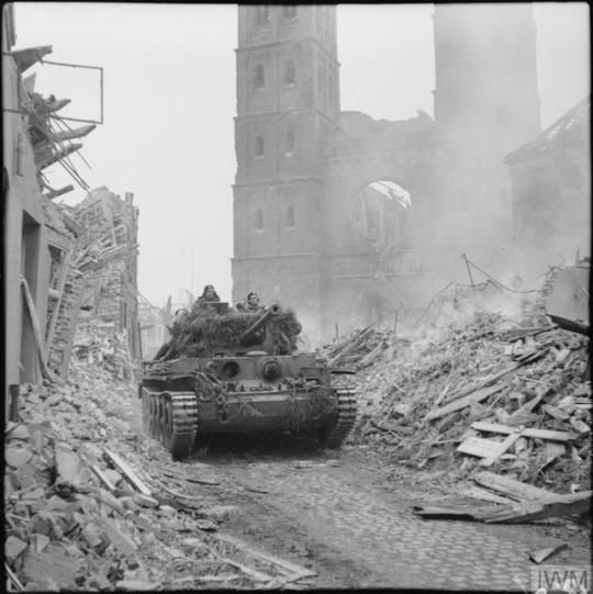 WW1,WW2 PHOTOS & FILMS    A Cromwell tank of 15th/19th King's Royal Hussars, 11th Armoured Division, with infantry aboard, advances through the rubble of Uedem, Germany, 28 February 1945.