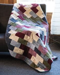 Flannel Bricks by Nancy McNally is a quilt recommended for log cabins, blizzards, fireplaces, sweetie-pies and afternoon naps.