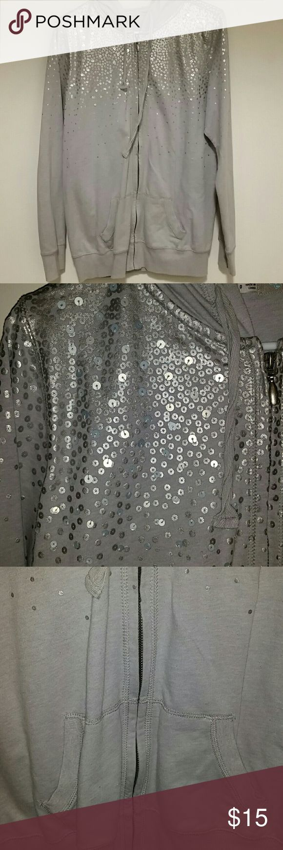 Sequined silver zip up hoodie Sequined silver zip up hoodie.  Sequins are closer together towards the top then spread out towards the bottom.  Full zip up hoodie with front pocket.  Some pilling under the armpit area and regular wear. FUC. Maurices Tops Sweatshirts & Hoodies