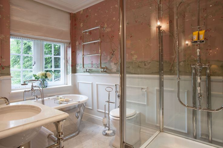 En-suite bathroom with traditional freestanding bath and shower inspired by Louis XV era | JHR Interiors