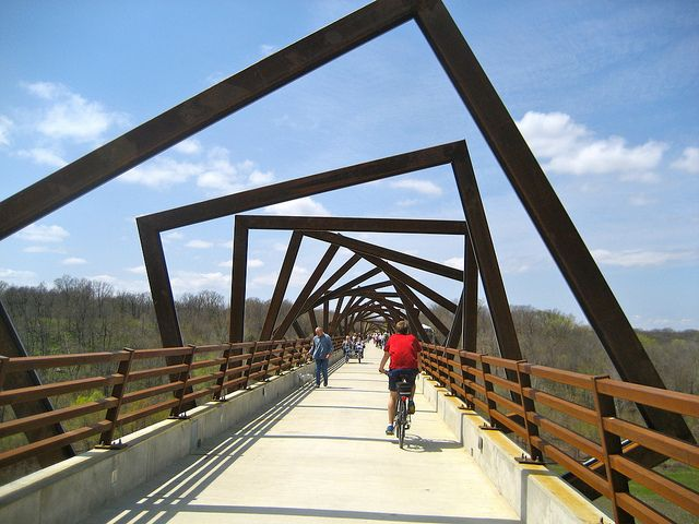 High Trestle Bridge in Iowa--  Bike ride on the High Trestle Trail in Iowa. It's one of the largest pedestrian bridges in the world at 13 stories high and 1/2 mile long. The 'frames' are designed to give the appearance of looking into a mine shaft, as the area was known for its coal mining.