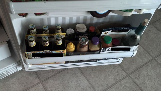 Use six-pack containers to organize the door shelves.