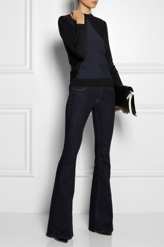 Women's fashion | Edgy black sweater, dark flare jeans and a matching clutch