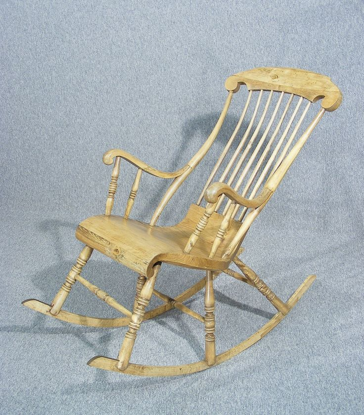 A beautiful, rare antique Swedish Gungstol rocking chair dating from c 1830 - 1850 This is one of the most comfortable chairs you will ever sit in. In the normal position the chair tilts right back to an almost horizontal stance. Totally handmade, the seat and frame are sculptured out of pine and the back is curved to accommodate the shape of your back