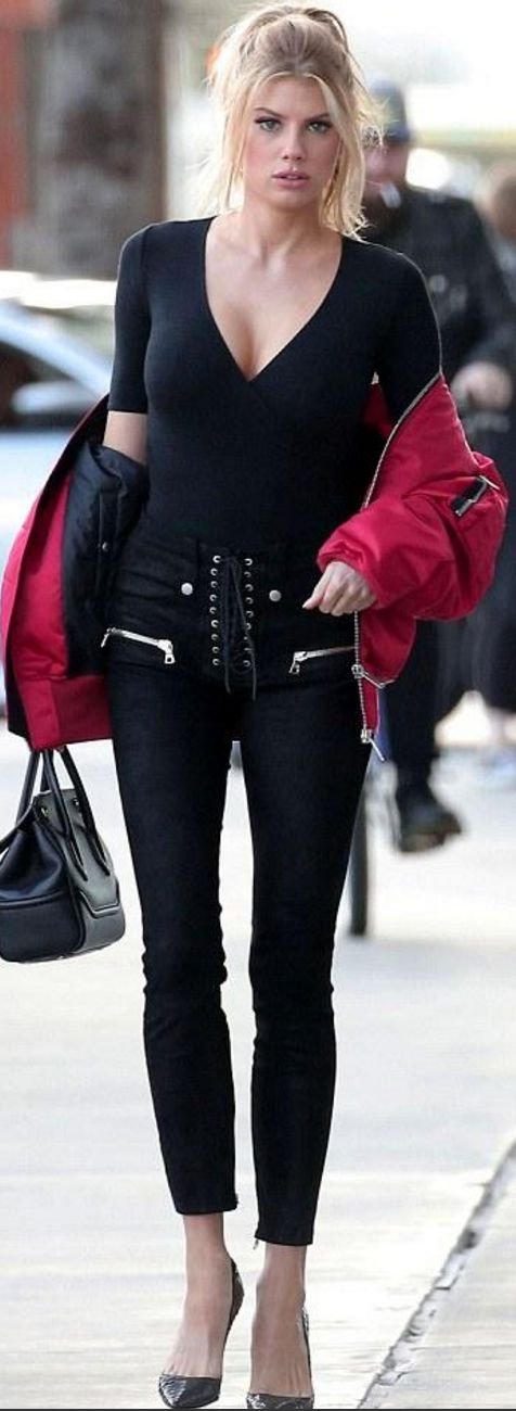 Who made Charlotte McKinney's red bomber jacket, pumps, handbag, black pumps, and lace up pants?