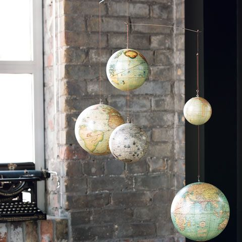Discover the history of the world with an eye-catching display symbolizing the advancement of cartography. Featuring original, correct details from models created through the 16th to 20th centuries, five different vintage inspired globes hang beautifully from a simplistic frame. Mobile measures 42 1/2 x  35 1/2 and comes packaged in Olive & Cocoa® gift wrap with ribbon. Minor assembly required.