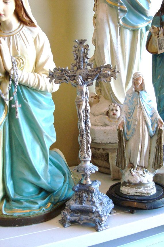 crucifix with statues