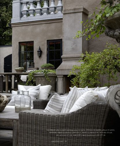 love the idea of grey rattan outdoor seating mixed with wrought iron furniture