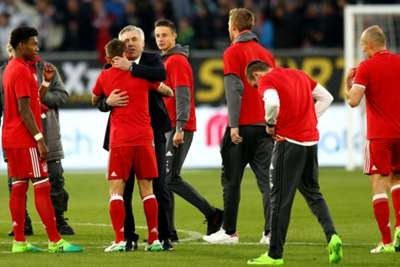 """Carlo Ancelotti thanked his Bayern Munich """"family"""" after the clubsealed their fifth successive Bundesliga crown with an emphatic 6-0 win over Wolfsburg.  RB Leipzig's goalless draw against lowly Ingolstadt earlier on Saturday left the door ajar for Bayern to retain their title and itwas all but secured when David Alaba's stunning free-kick and a Robert Lewandowski brace put them 3-0 up at half-time.  Second-half goals fromArjen Robben Thomas Muller and Joshua Kimmich added further gloss to…"""