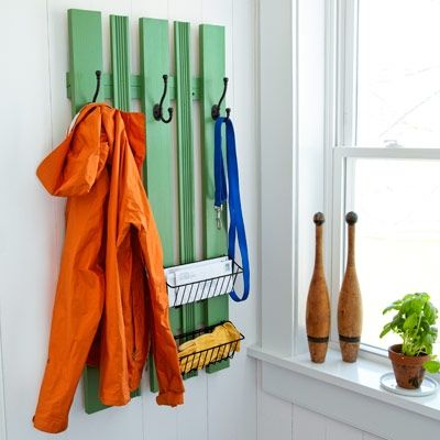 Why not build a board-and-batten-like coatrack to maximize storage space and add cottage flavor to your home? Double coat hooks and wire baskets are a bonus.