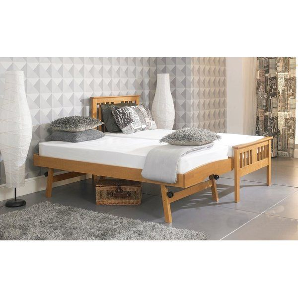 The 3ft single wooden guest bed frame is made from solid wood and finished in White. Elegant and stylish without compromise on quality, this bed is a very popular design and will accommodate most interior decors. Giving the most flexibility of any guest bed it can be used as a single bed, 2 single beds, or super king bed making the best possible use of that guest room space. The under bed guest part is pulled out from under the frame and has legs that enable the guest bed to be the same…