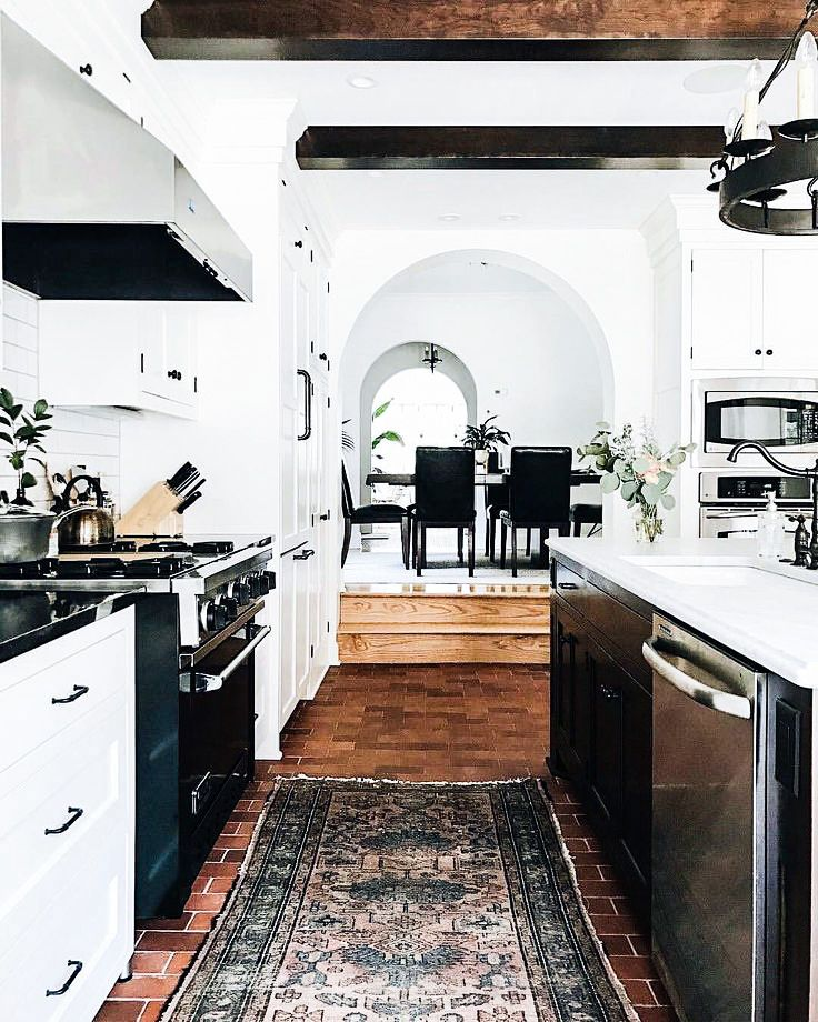 Love this black and white rustic modern kitchen. It's so cozy and classic and dramatic all at once.