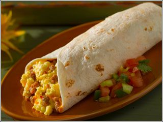 New Mexican style Breakfast Burrito: Scrambled eggs, potatoes, chorizo or bacon, and of course, red or green chile.