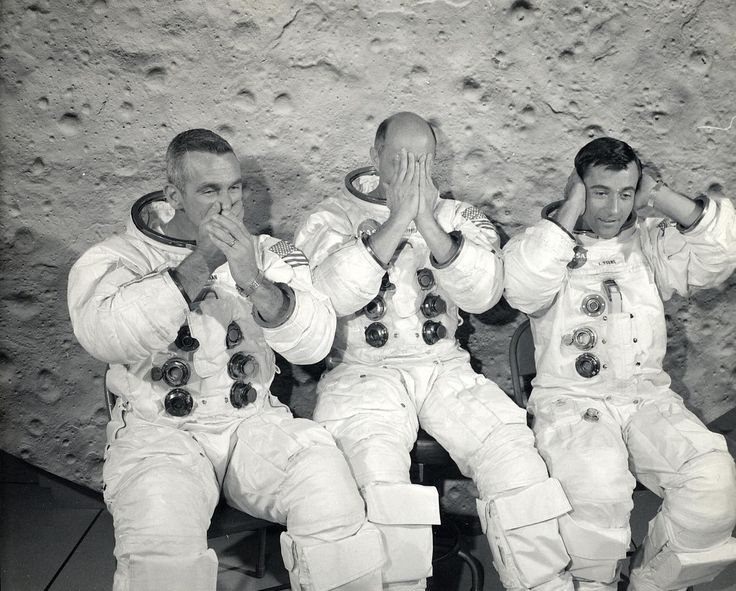 Apollo 10 astronauts Gene Cernan, Tom Stafford, and John Young goof around when they pose for their crew portrait, circa 1969. (NASA)