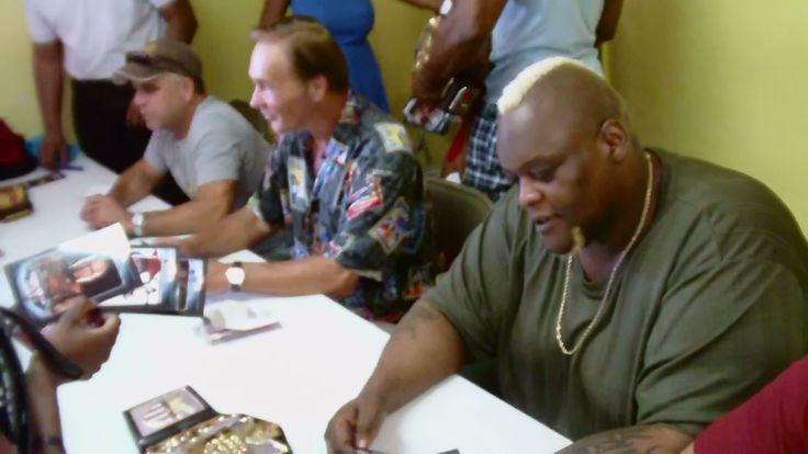 Randy Eller, Larry Zbyszko, Nelson Frazier Jr, signing autographs for the smallest of fans.
