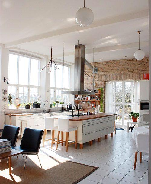 cool bricks + big windows + central island kitchen