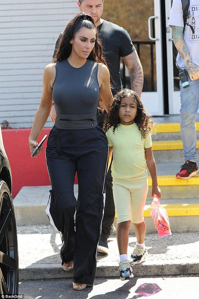 ceb0d0f702b Kim Kardashian rocks edgy grey tank as she steps out with North West ...