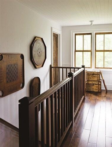 Nostalgic Staircase Landing (© Janet Kimber) ---- old crokinole board as decor! LOVE