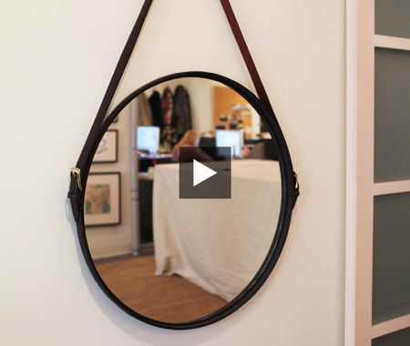 Great tutorial from House & Home that makes it look super easy and cheap (they use a big Ikea mirror). Enjoy!