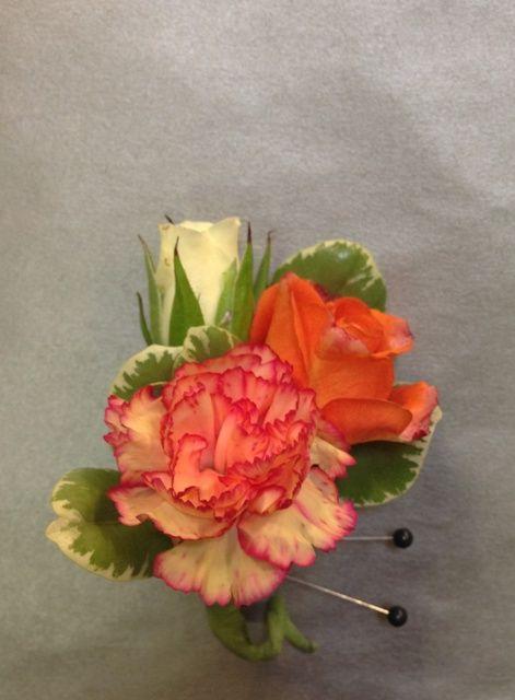 Orange carnation boutonniere
