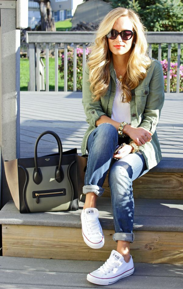 Asparagus jacket under white blouse and blue jeans and hand bag