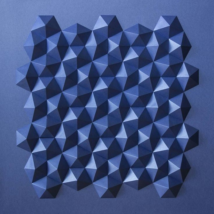 M.C. Escher loved to use the grid of pentagons which served me as a geometrical skeleton for this piece. It is a 65x65x3cm piece in velvety blue coated paper consisting of 60 pyramids. This pentagonal pattern has a 4-fold symmetry and can be derived from a square grid. There is a kind of tension between the felt square grid background and the pentagonal figures in front of it which I especially like.