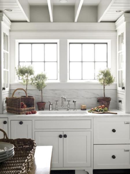 crisp white glass front kitchen cabinets, oil rubbed bronze hardware