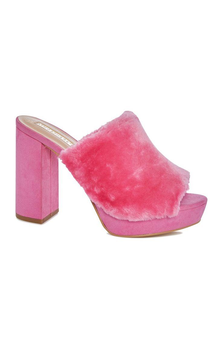 Roze fluffige muilen met blokhak