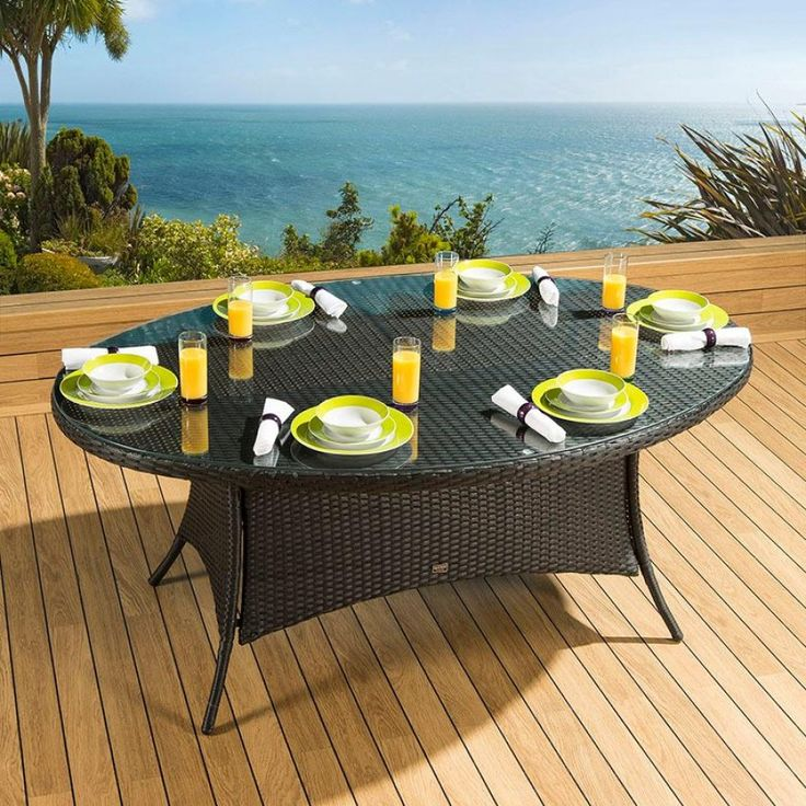 Massive luxury garden/outdoor oval dining table black rattan. Made from fully weatherproof PE rattan, hand woven over a rust resistant frame. This maintenance free table is designed to be left outside all year round without the need for covering. The frame is made from 1.2 mm thick aluminium tube with grey powder coating applied after welding. It is UV light resistant to ensure that the coloured rattan does not fade in the sunlight.