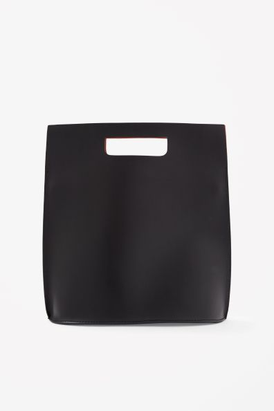 COS Contrast leather bag made from smooth leather, this bag is a narrow bucket shape with a contrasting bright orange interior.