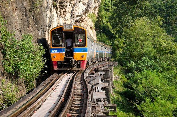 Train travel on the River Kwai Bridge at Kanchanaburi in Thailand