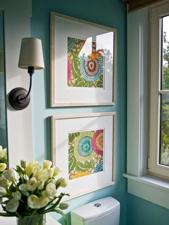 Framing fabric or scrapbook papers as art. I'm thinking great idea in my craft room :)